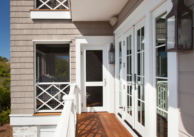 Shingle Home Balcony railing. This balcony with Ipe deck boards lead you directly to a screened-in porch. Shingle Home Balcony railing ideas. Shingle Home Balcony railing. Shingle Home Balcony custom railing. #ShingleHome #Balconyrailing T.S. Adams Studio, Architects
