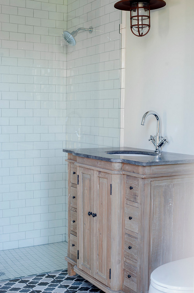 Reclaimed white oak wood bathroom cabinet. Bathroom features reclaimed white oak cabinet with whitewash and cement floor tiles. #bathroom #whiteoak #whitewash #cabinet #reclaimedwood #cementtiles Heritage Homes of Jacksonville