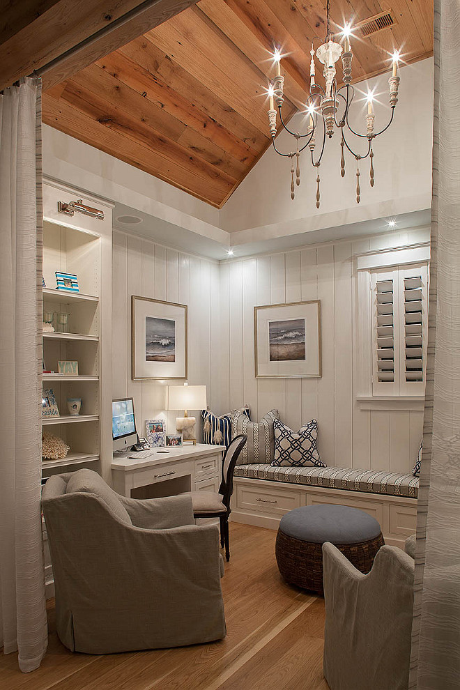 Home Office Den Ideas. Small home office, den with reclaimed plank wood ceiling, vertical shiplap wainscoting and built-in cabinetry. Draperies add some privacy to the space. #homeoffice #den #wainscoting #shiplap #verticalplanks #verticalwallplank #verticalshiplap #reclaimedwoodceiling #reclaimedwood #reclaimedfloors #plankfloor Savoie Architects.