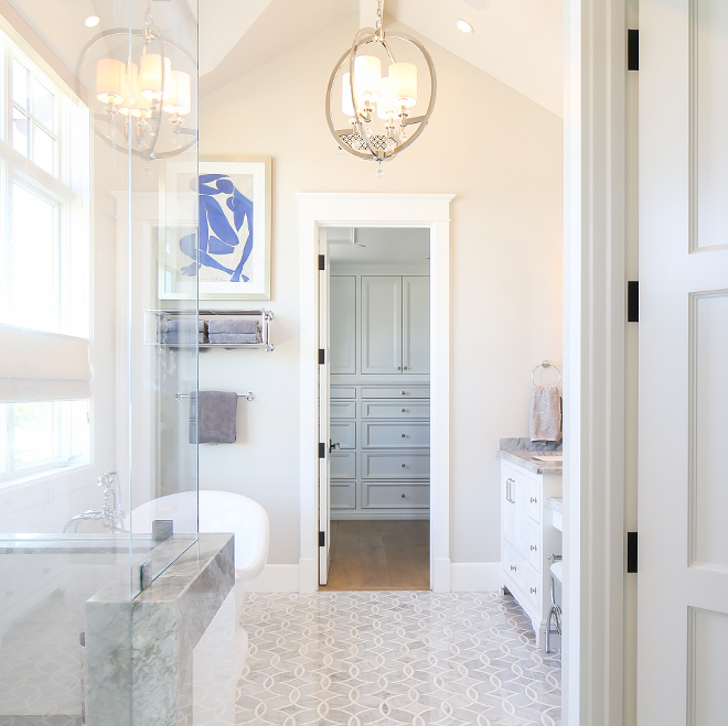 Bathroom floor tiles. The floor tiles are New Ravenna Mosaics Carrara with Thassos Tile in a Zazen Pattern. #bathroom #floortiles Patterson Custom Homes. Interiors by Trish Steele, Churchill Design.