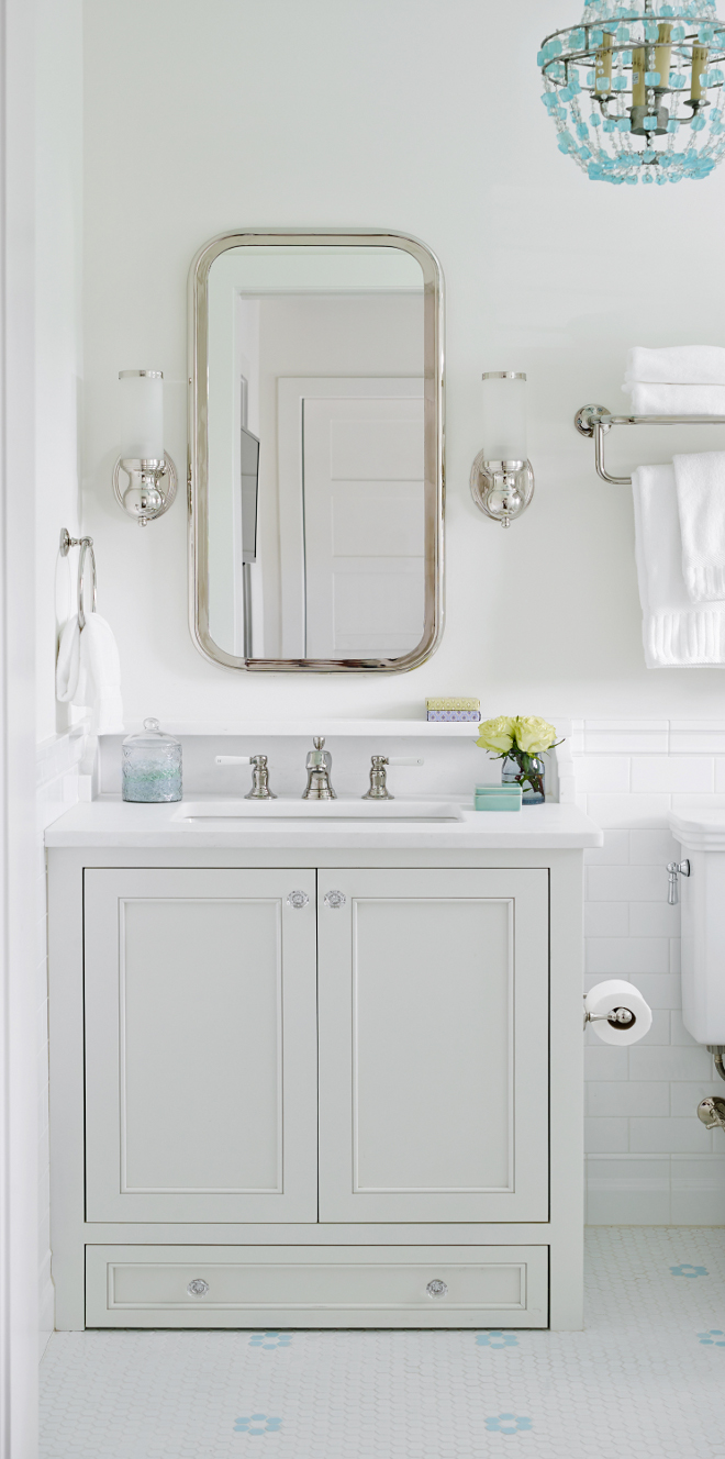 Bathroom with small vanity. This bathroom features a small vanity with glass knobs, white marble countertop and shelf. The vanity comes with a built-in step stool at the bottom. It's a step for one of the kids who couldn't quite reach the sink yet. Bathroom small vanity dimensions. Bathroom small vanity ideas. Bathroom small vanity decor. Bathroom small vanity design. Small vanity knobs. #Bathroomsmallvanity #Bathroom #Smallvanity #smallvanitydimension #smallvanityideas #smallvanitydesign #smallvanitybathroomideas #Bathroomsmallvanityknobs T.S. Adams Studio, Architects