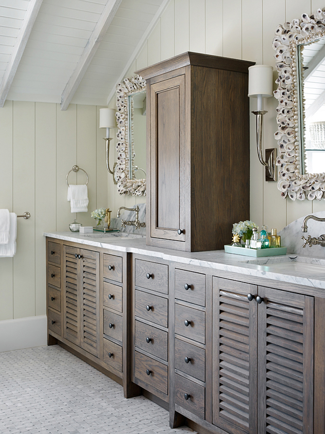 Reclaimed white oak cabinets with marble countertop. This bathroom features Reclaimed white oak cabinets with marble countertop and shell mirrors. #Reclaimedwhiteoak #whiteoakcabinets #marblecountertop #whiteoakcabinetmarblecountertop #ShellMirror T.S. Adams Studio, Architects
