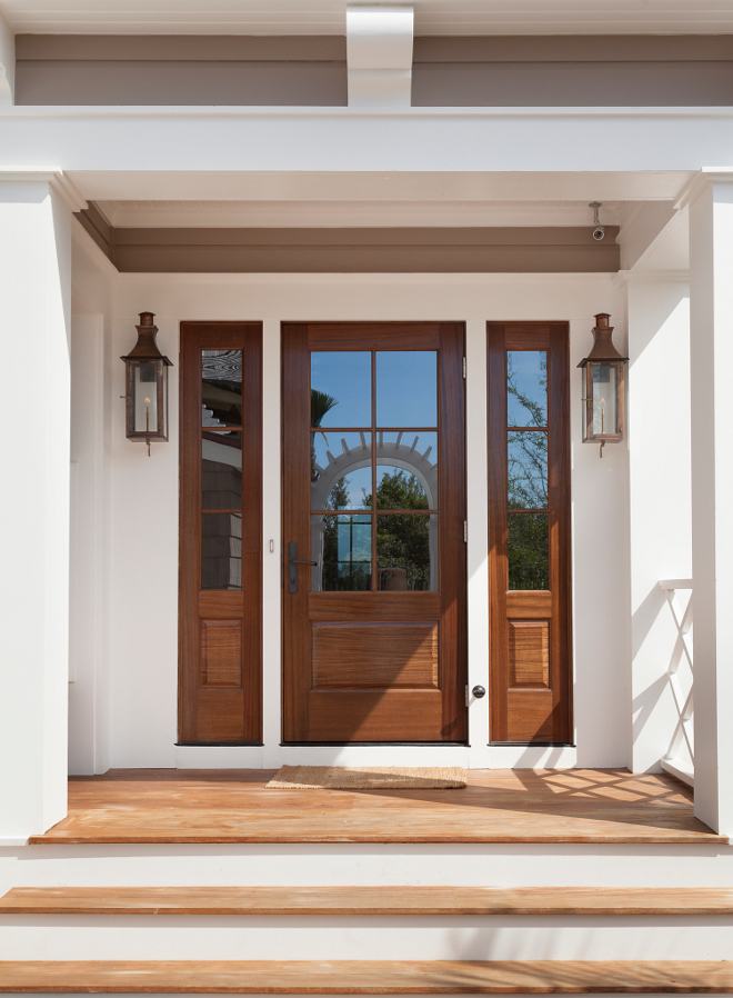 Wooden front door and sidelights. This home features beautiful wooden front door and sidelights. Wooden front door and sidelights. Natural Wood front door and sidelights #Woodenfrontdoor #woodfrontdoor #wooddoor #woodsidelights #frontdoor #woodsidelight T.S. Adams Studio, Architects