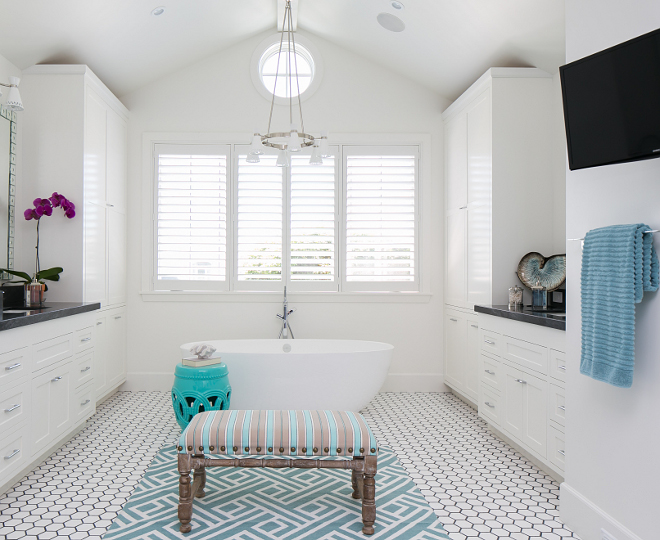 "Bathroom lighting and flooring. Lighting is Jonathan Adler's Havana 6 Light Chandelier (Model W709), Powder Coat Shade -  $796.95  Flooring is 4"" White Thasos with 1/4"" Bardiglio border.   Patterson Custom Homes. Brandon Architects, Inc."