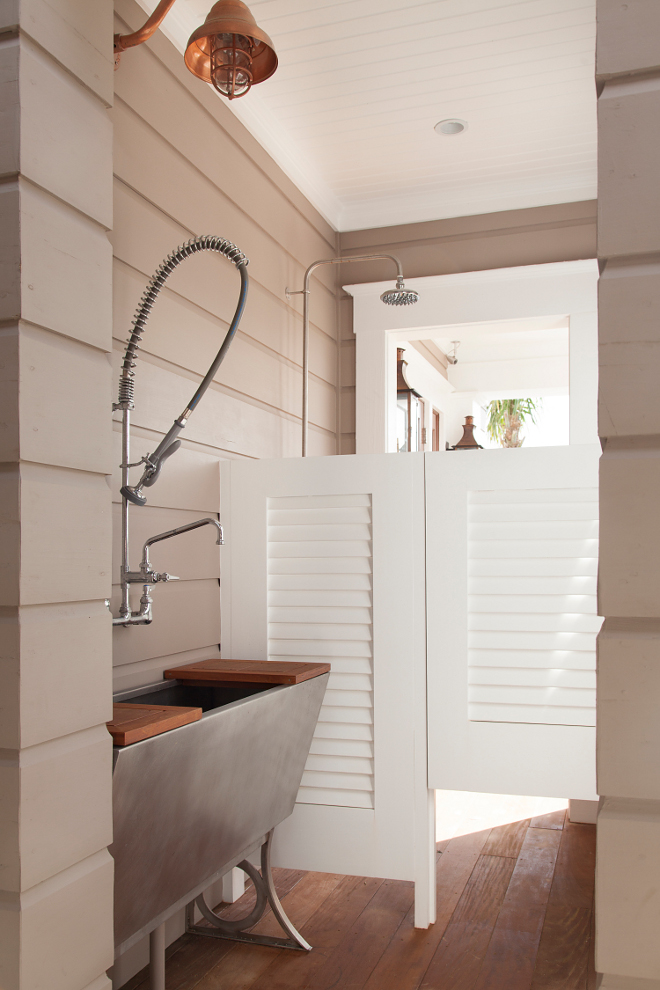 Outdoor shower. Outdoor spaces. Outdoor sink. Just off the front entry, this private space features a stainless steel sink and an outdoor shower. The shower is perfect to wash-off the sand from the beach and the sink is ideal to wash the pups! Isn't it a brilliant idea for a beach house? Actually, for any house! #outdoors #outdoorshower #beachhouse #sink #outdoorsink T.S. Adams Studio, Architects