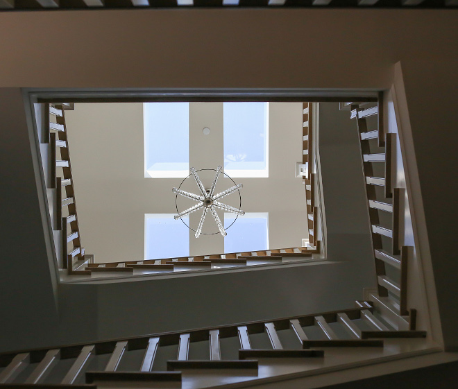 Skylight. The staircase feature skylights to bring some natural light in. Isn't it a smart and beautiful idea? #Skylight #skylights Patterson Custom Homes. Interiors by Trish Steele, Churchill Design.