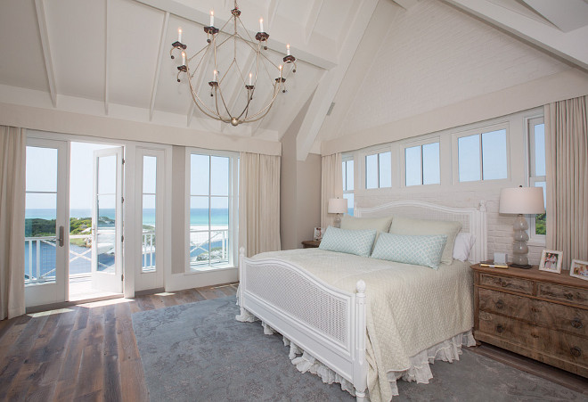 Beach House master bedroom. Master bedroom. Neutral beach house master bedroom with ivory decor and vaulted ceiling. #Masterbedroom #Beachousebedroom #ivorybedroom #vaultedceiling #neutralbedroom #neutralbeachinteriors #neutralcoastalinteriors #interiors T.S. Adams Studio, Architects