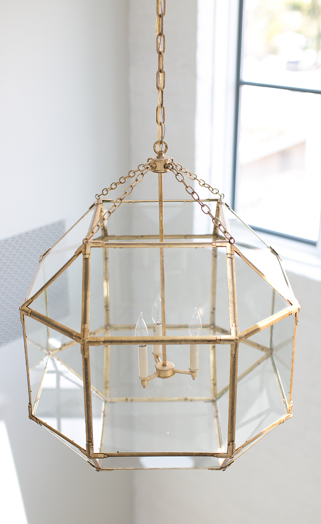 Suzanne Kasler Morris Lantern in Gilded Iron. Lots of contrasting elements make for a bold statement on this ceiling... white tongue and groove (not shown), reclaimed wood beams & skylight trims, painted railings & a pop of brass. Lighting is Suzanne Kasler Morris Lantern in Gilded Iron #SuzanneKaslerMorri Lantern #GildedIron Patterson Custom Homes