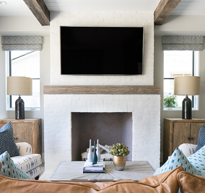 "Fireplace Mantel Height. Reclaimed wood fireplace mantel Height. The mantel starts at approximately 48""H. #Matelheight #mantleheight #mantelheightideas Patterson Custom Homes"