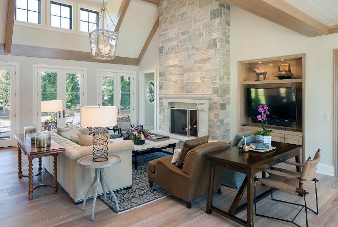 White Oak engineered wood floor. Living room with stone fireplace and White Oak engineered wood floor. #WhiteOakengineeredwoodfloor #WhiteOakwoodfloor Scott Christopher Homes