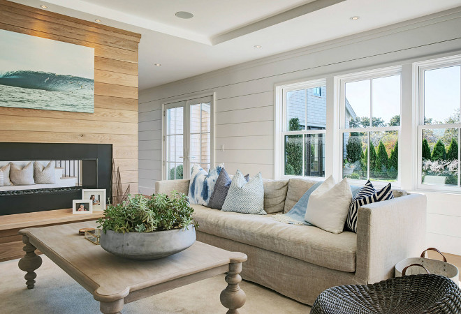 beach home  beach style  blue pillow  coastal decor  entertain  linen couch  Nantucket  natural  open floor plan  shiplap siding  two way fireplace  wood coffee table   Hanley Development.