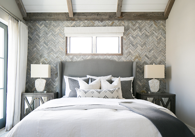 Master bedroom wall features white washed reclaimed wood in a herringbone pattern. Patterson Custom Homes