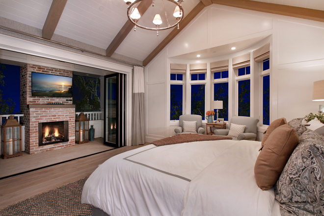 Bedroom Layout. The bedroom features patio folding doors to a private balcony with fireplace. #Bedroom #Bedroomlayout #BedroomBalcony #balcony Patterson Custom Homes. Interiors by Trish Steele, Churchill Design.
