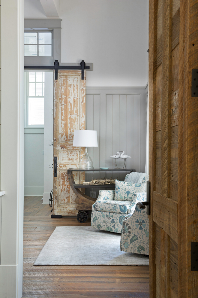Bedroom Reclaimed Doors and Hardware. The master bedroom features antique doors hung with barn door hardware and a wooden reclaimed door. Reclaimed doors – Charles Phillips Antiques, hardware – Ashley Norton #Reclaimedwooddoors #AntiqueDoor #Hungantiquedoor #Antiquedoor #Barndoorharware