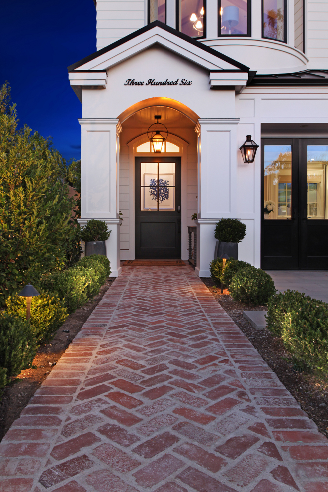 A brick pathway leads you to the front door. Patterson Custom Homes. Interiors by Trish Steele, Churchill Design.