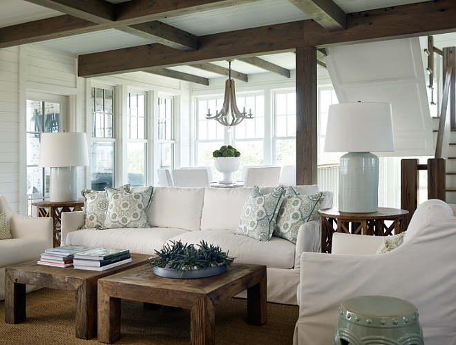 Living room decor tips. In the living room, a white slipcovered sofa and chairs come to balance the natural elements, such as the reclaimed beams and wooden coffee tables. #Livingroom #DecorTips #DecoratingTips #InteriordesignerTips #designertips T.S. Adams Studio, Architects