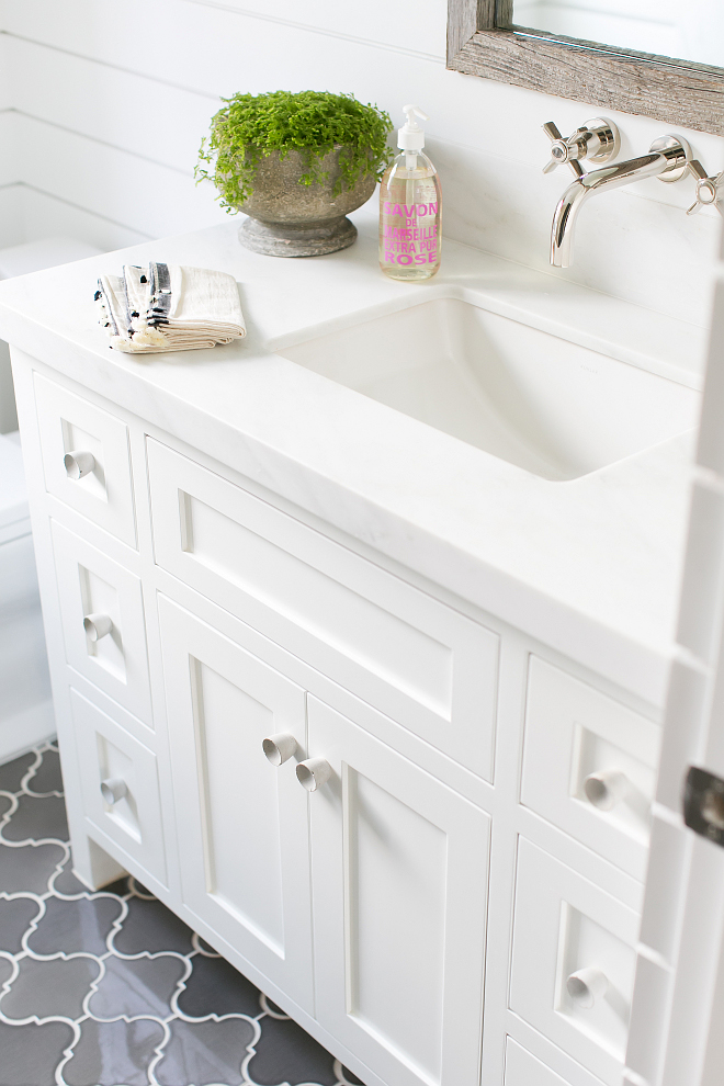 The bathroom countertop is pacific white marble slab. The bathroom countertop is pacific white marble slab. #bathroom #countertop #pacificwhite #marbleslab Patterson Custom Homes