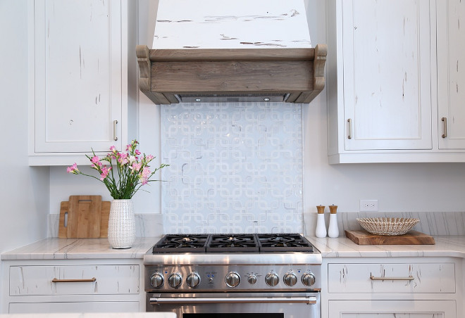 Reclaimed kitchen cabinet and hood. Reclaimed kitchen cabinet and hood ideas. Reclaimed kitchen cabinets are pecky cypress and hood features cypress wood. #reclaimedkitchen #reclaimedkitchencabinet #reclaimedhood #kitchen #preckycypress #cypresscabinet Old Seagrove Homes.