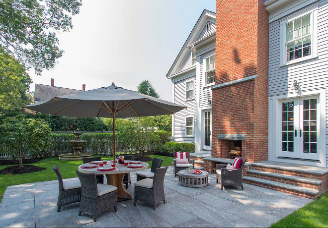 Backyard patio with outdoor brick fireplace. Siemasko + Verbridge