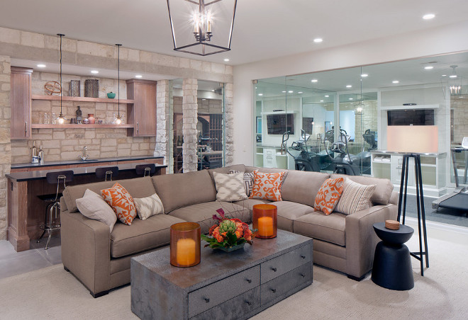 Basement living room opens to a glass enclosed gym. Basement Gym. Basement. Home Gym. #Basement #HomeGym #BasementGym Scott Christopher Homes