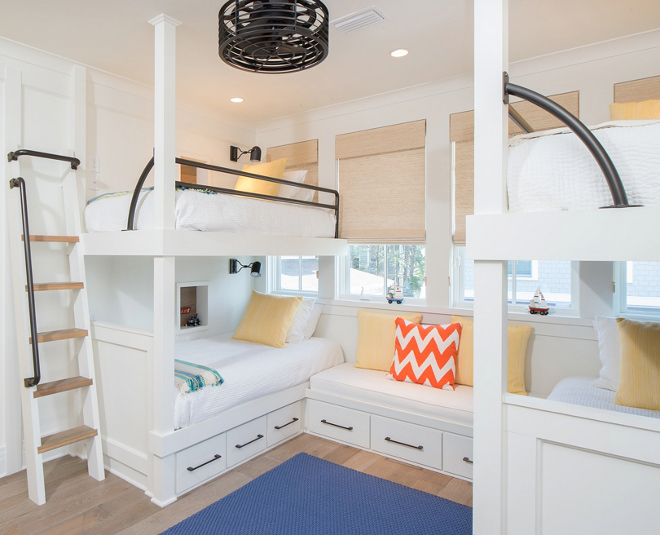 Bunk Room. The bunk room is perfect for the homeowner's grandchildren. It features custom bunk beds with iron railings. Bedding and pillows: Pine Cone Hill. Wood Floors: Character Grade Oak in Heritage finish. Treads on ladder and underneath Bunk Beds: cypress wood. Bunk Bed Hardware: Ashley Norton Hardware. #bunkroom Interiors by Courtney Dickey of TS Adams Studio.