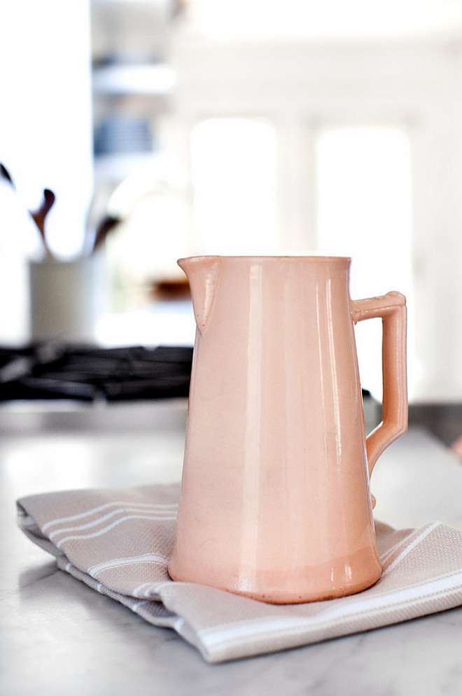 Ceramic pitcher. Kitchen accessories. A few kitchen accessories bring color to this two-toned kitchen. #kitchen #accessories #pitcher Elizabeth Lawson Design