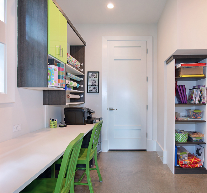 Craft Room. Kids computer station craft room. Fun craft room with cabinets by California Closets, concrete floor, wrapping station and lots of desk space for the children. #Kids #CraftRoom #computerstation #homeoffice