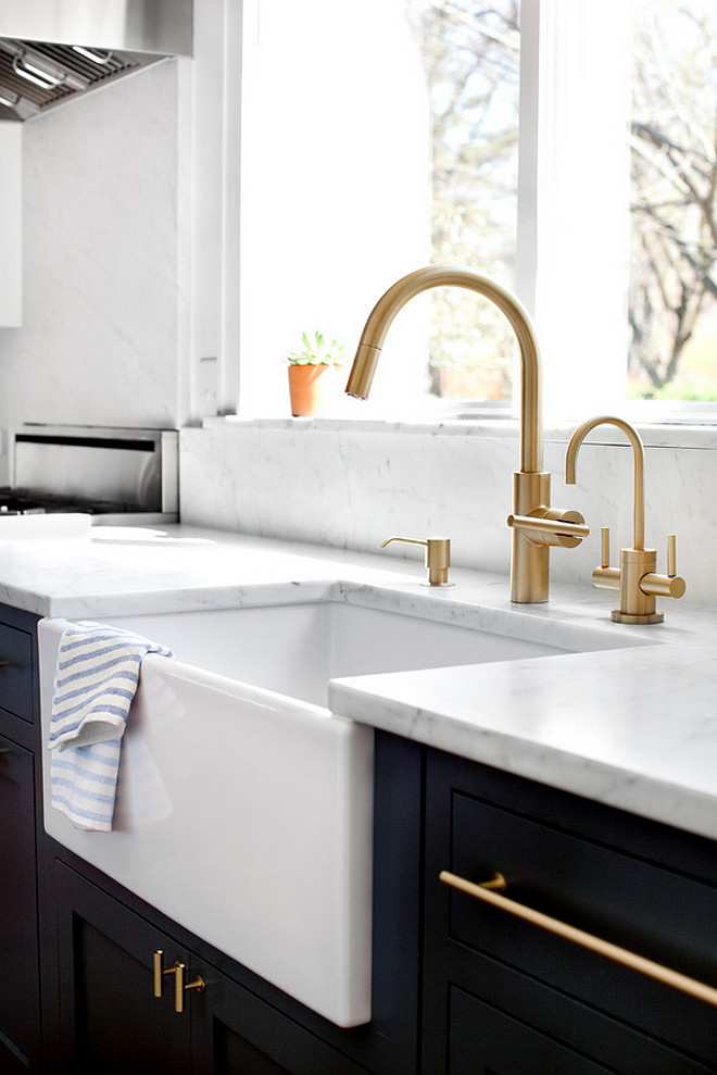 "Farmhouse sink and faucet. Farmhouse sink faucet ideas. Kitchen farmhouse sink and faucet. The faucet, soap dispenser and hot water dispenser are the East Linear from Newport Brass. This is their Satin Brass finish. The farmhouse sink is a 30"" Rohl. #kitchen #farmhousesink #apronsink #faucet #kitchenfaucet #sink Elizabeth Lawson Design"