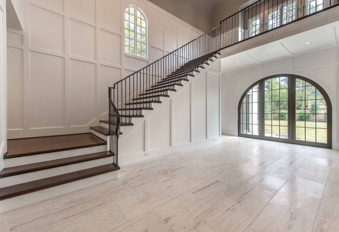 Foyer wainscoting and steel stair railing. Double height Foyer wainscoting and steel stair railing. #Foyer #wainscoting #steel #stairrailing Elizabeth Garrett Interiors.