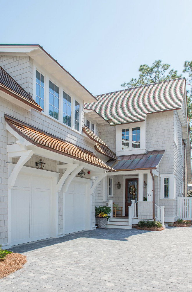 Benjamin Moore OC-117 Simply White. Exterior trim and garage doors paint color is Benjamin Moore OC-117 Simply White. Benjamin Moore OC-117 Simply White exterior. #BenjaminMooreOC117SimplyWhite #BenjaminMooreOC117 #BenjaminMooreSimplyWhite #BenjaminMoore #OC117 #SimplyWhite Interiors by Courtney Dickey of TS Adams Studio.