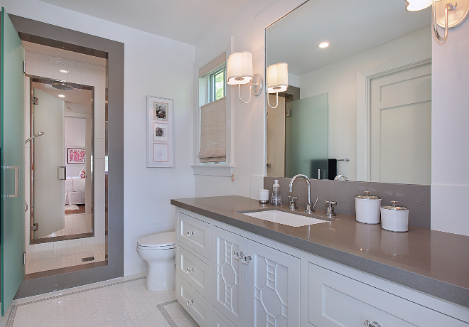 Jack and jill bathroom. This bathroom features white subway tile, with glass wall accent in the center shower, Caeserstone encased shower and vanity top. Closets are by California Closets. Patterson Custom Homes. Interiors by Trish Steele of Churchill Design.