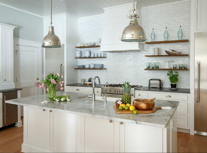 Kitchen Bertazzoni bluestone bungalow coastal style farm sink herringbone pattern kitchen remodel Kohler marble countertops painted brick reclaimed beams reclaimed shelves shaker style shiplap soapstone countertops Thermador vaulted ceilings white oak Heritage Homes of Jacksonville