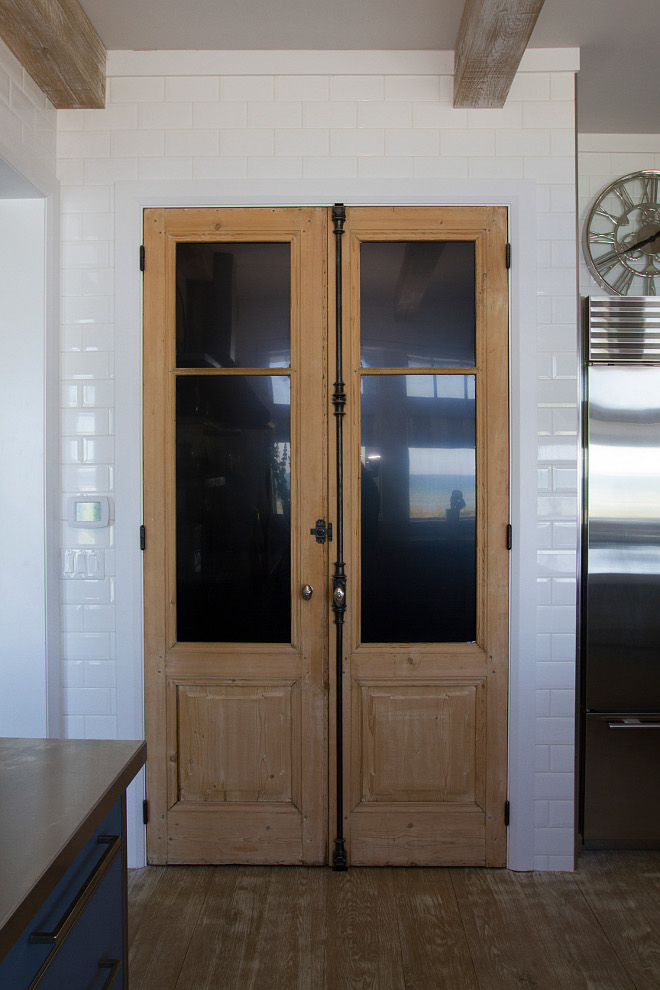 Kitchen pantry antique doors. The pantry features a 19th Century pair of French Doors w/ Cremones. #Kitchen #pantry #doors #antiquedoors #antiqueFrenchDoors Heritage Homes of Jacksonville and Villa Decor & Design