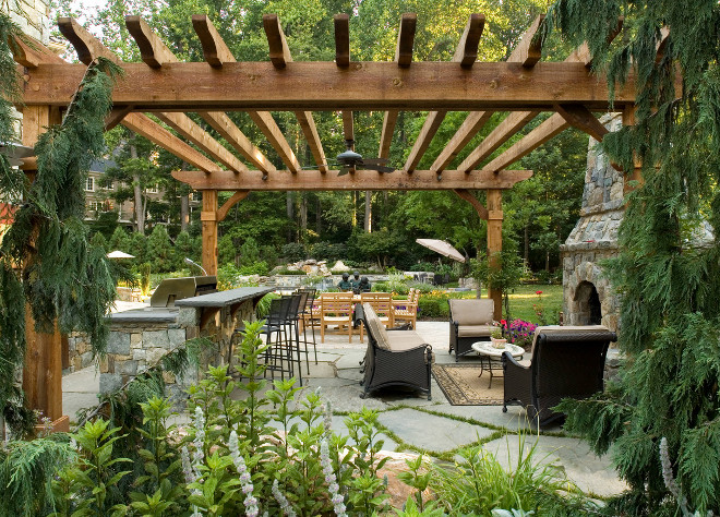 Large Pergola. Large patio pergola with flagstone patio and stone fireplace. #Patio #Flagstone #fireplace #perfgola SURROUNDS Landscape Architecture + Construction