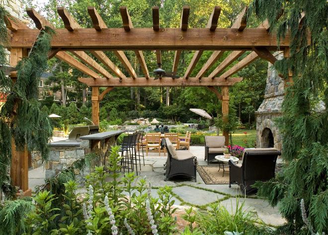 Large Pergola. Large patio pergola with flagstone patio and stone fireplace. #Patio #Flagstone #fireplace #perfgola SURROUNDS Landscape Architecture + Construction