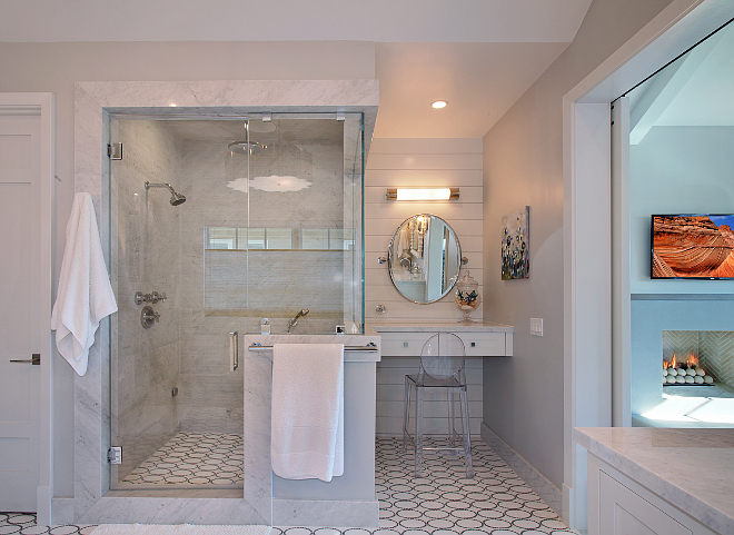 Master Bathroom Shower. The shower features steam shower and bamboo finish Carrera marble on shower walls. Patterson Custom Homes. Interiors by Trish Steele of Churchill Design.