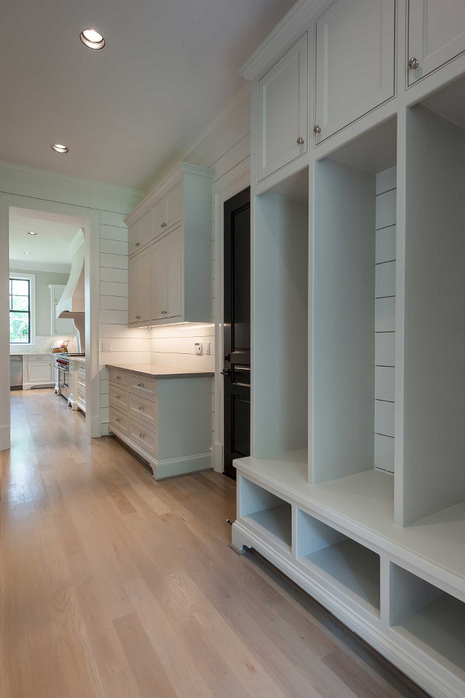New mudroom project. Mudroom with shiplap walls, white oak hardwood floors and custom cubbies. #mudroom Elizabeth Garrett Interiors