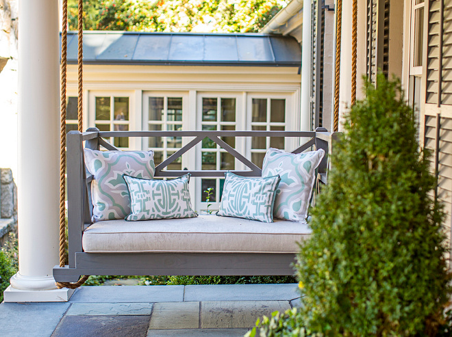 Porch Swing. Gray porch swing. Porch swing with pillows and linen cushion. Porch swing #Porch #swing #Porchswing #Porchswingpillows #Porchswingcushion #GrayPorchswing Tillman Long Interiors.