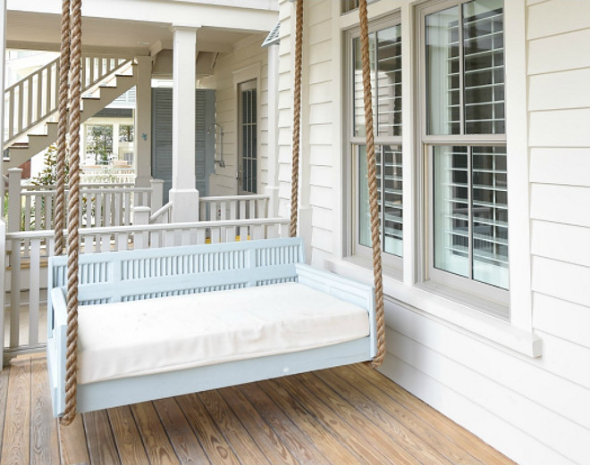 Porch Swing. Blue porch swing painted in Benjamin Moore Kentucky Haze. Porch swing with rope. Coastal porch swing with rope and painted in a blue paint color, Benjamin Moore Kentucky Haze.Interiors by Courtney Dickey of TS Adams Studio.