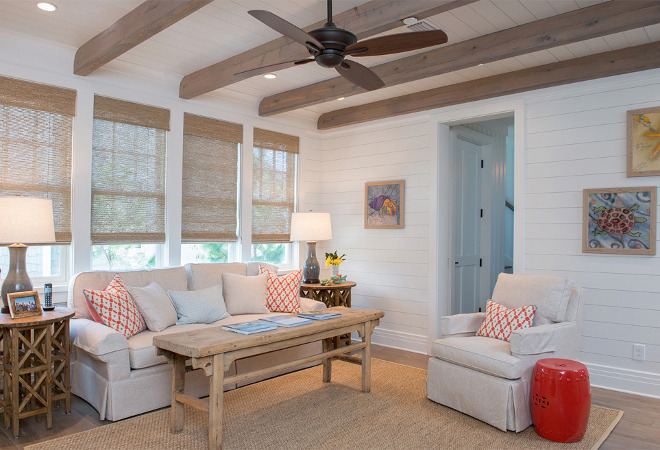 Living room Shiplap walls painted in Benjamin Moore White Dove and oak beams with weathered oak stain. Woven shades are custom. Interiors by Courtney Dickey of TS Adams Studio.