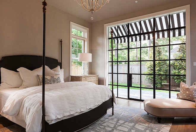 Steel Window and Doors. Bedroom Steel Window and Doors. Bedroom with Steel Window and Doors opening to garden. #SteelWindow #SteelDoors #bedroom Elizabeth Garrett Interiors. Connie Anderson Photography.