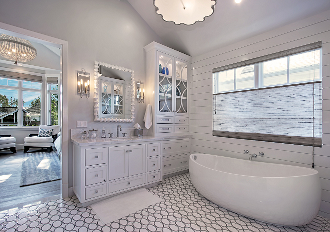 White Master Bathroom Cabinet. The master bathroom features amazing custom water jet floor, free standing tub, beautiful storage and glass cabinetry flank tub. Patterson Custom Homes. Interiors by Trish Steele of Churchill Design.