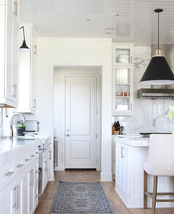 White kitchen lighting Ideas. White kitchen with black and brass pendants. Kitchen lighting is by Rejuvenation. Kitchen lighting. #Kitchenlighting #Kitchenlight #Kitchenlightingideas Becki Owens.