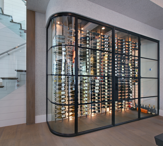 Wine Cellar. Beautiful custom black steel and glass wine cellar. #blacksteelandglasswinecellar #winecellar Patterson Custom Homes. Interiors by Trish Steele of Churchill Design.