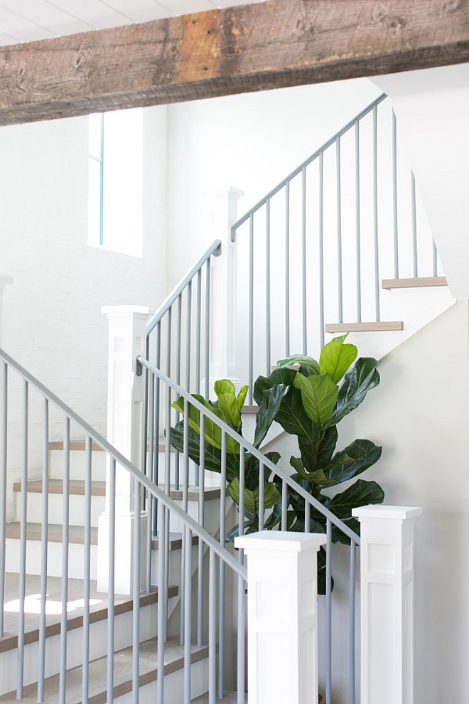 "White newel post paint color. Trims and the craftsman style newel posts are painted in ""Dunn Edwards 2005 Evershield Semi-gloss"". #newelpost #trim #staircase #paintcolor #DunnEdwards2005Evershield"