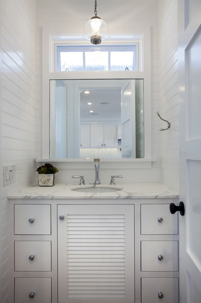 Small Powder room with floor to ceiling Tongue and Groove Wainscot Paneling. Tongue and Groove Wainscot Paneling Powder Room. #PowderRoom #TongueandGroove #WainscotPaneling #Wainscoting #paneling Graystone Custom Builders