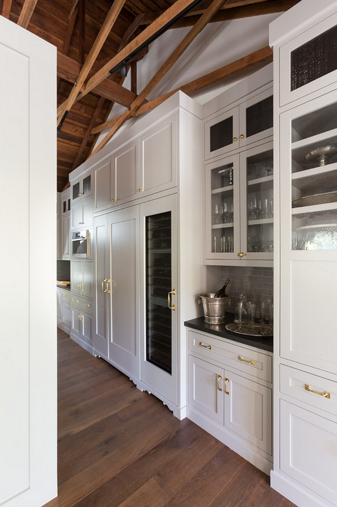 Kitchen paint color ideas. Kitchen cabinet paint color that works perfectly with hardwood floors and brass hardware. Kitchen paint color is C2 paint 490P. #Kitchen #Cabinet #PaintColor #C2 #490P HSH Interiors