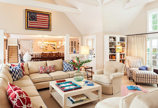 After selling a large, family home in suburban Boston, and moving into an apartment the city, our clients decided to renovate their summer home on Cape Cod. Caroline collaborated with Robin Violandi on the project and the pair created spaces that feature a neutral palette interspersed with pops of color such as the nautical navy and red accents in the living room and a rich, blue hue on the base of the island in the kitchen. The wall color in the family room is BM Manchester Tan and the walls in dining room are covered in grasscloth by Ralph Lauren.Welch Company Home + Design