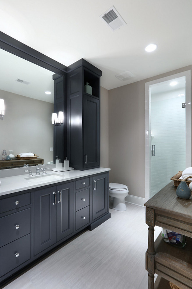 Charcoal gray bathroom cabinet. Charcoal gray bathroom cabinet with Revere Pewter by Benjamin Moore walls. Charcoal gray bathroom cabinet #Charcoalgray #bathroom #cabinet Francesca Owings Interior Design