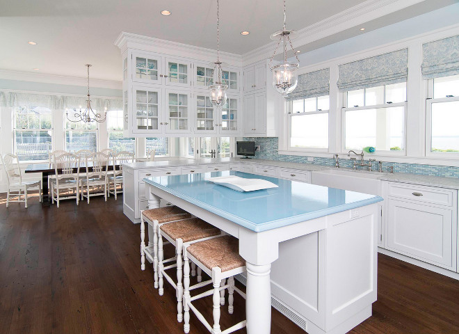 White and blue kitchen. White kitchen with light blue and turquoise accents. White, blue turquoise kitchen. The island is a material called Pyrolave and this was a custom color. #WhiteKitchen #bluekitchen #whiteandbluekitchen